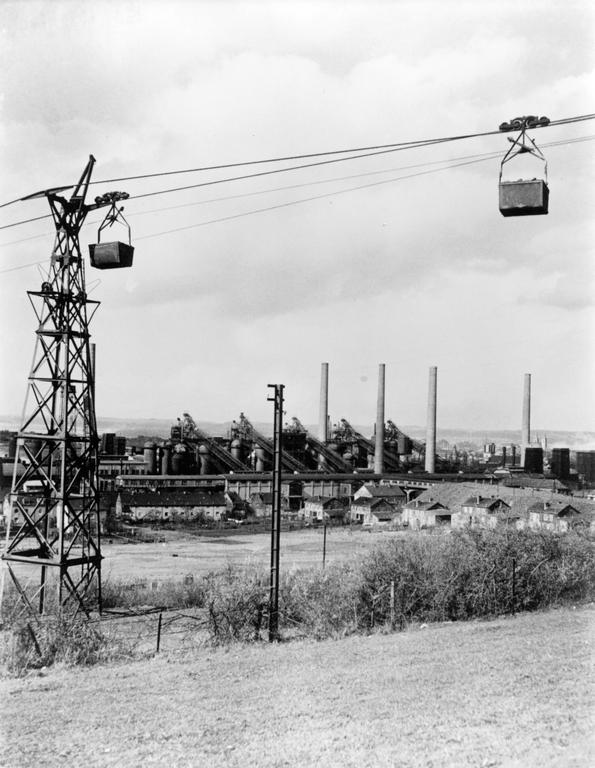 Iron ore transportation in front of the ARBED steel complex in Esch-sur-Alzette