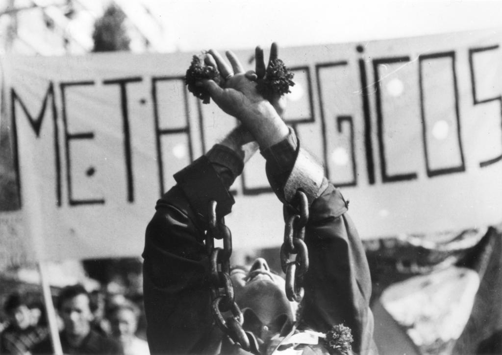 Portuguese demonstrator portraying the image of the people casting off their chains (April 1975)
