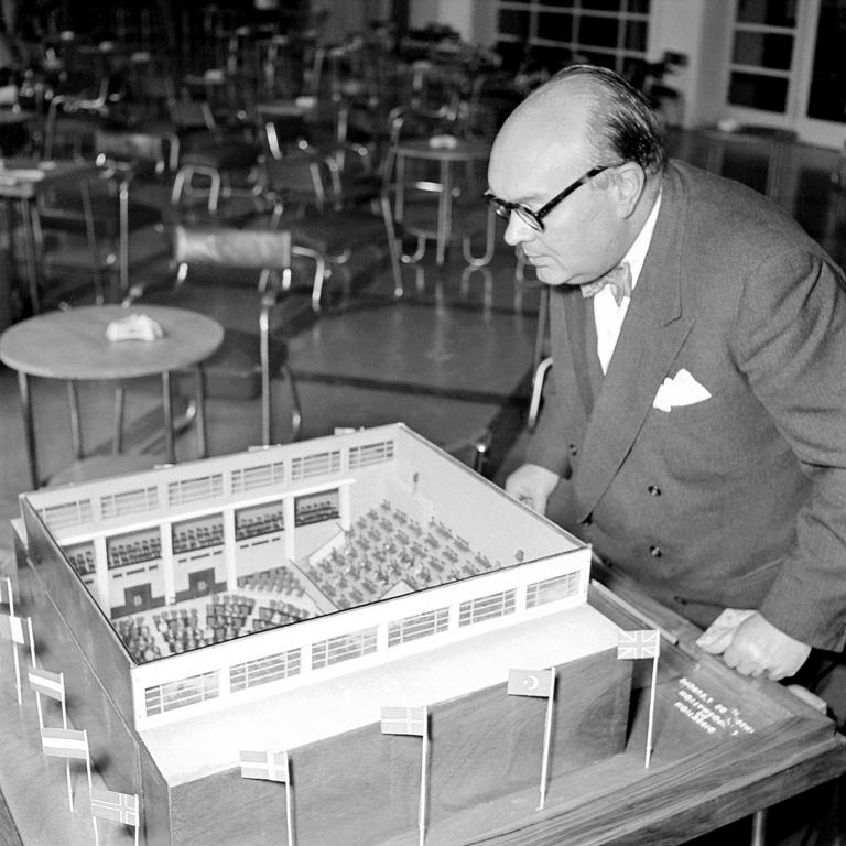 Paul-Henri Spaak in front of the model of the Consultative Assembly of the Council of Europe