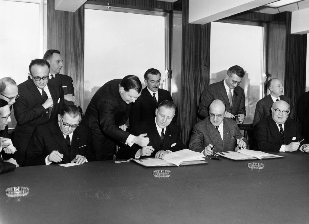 Pierre Werner, Eugène Schaus, Théo Lefèvre and Paul-Henri Spaak at the signing of the protocol revising the BLEU Convention (Brussels, 29 January 1963)